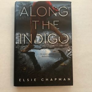 Along The Indigo by Elsie Chapman Hardcover Book